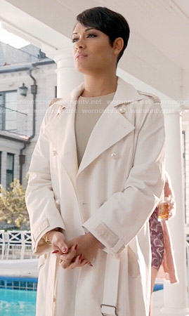 Anika's white trench coat with pearl buttons on Empire