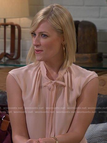 Caroline's blush tie-neck blouse on 2 Broke Girls