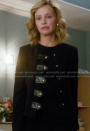 Cat's black jacket with leather tabs on Supergirl