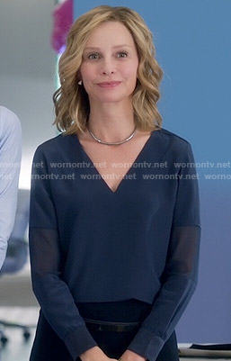 Cat's navy blue v-neck blouse on Supergirl