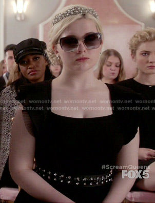 Chanel 5's black dress with ruffled sleeves on Scream Queens