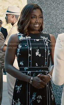 Daisy's black floral dress with white trim on Madam Secretary