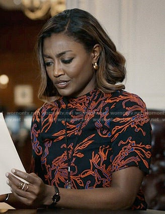 Daisy's black and orange printed top on Madam Secretary