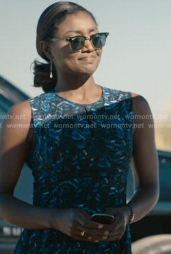 Daisy's blue printed peplum top and sunglasses on Madam Secretary