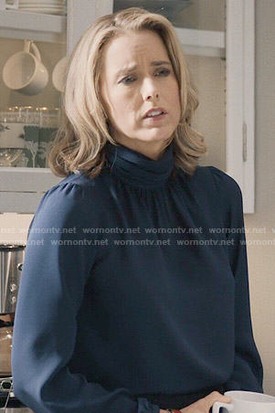 Elizabeth's navy blue turtleneck blouse on Madam Secretary