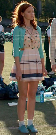 Cassandra's polka dot top, blue cardigan and striped skirt on The Librarians
