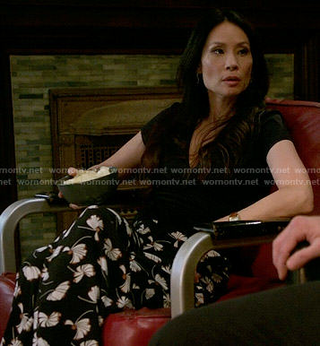 Joan's black printed pants on Elementary