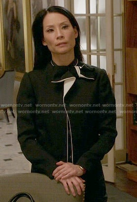 Joan's black bow jacket with white trim on Elementary