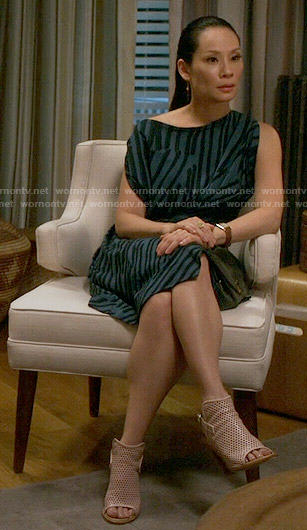 Joan's blue and black stripe printed dress on Elementary