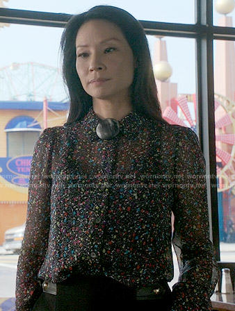 Joan's confetti print blouse on Elementary