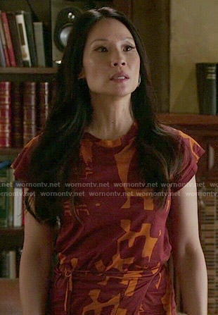 Joan's orange and red printed dress on Elementary