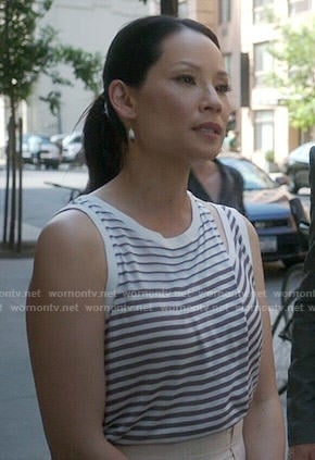 Joan's striped tank top with cutout shoulder on Elementary