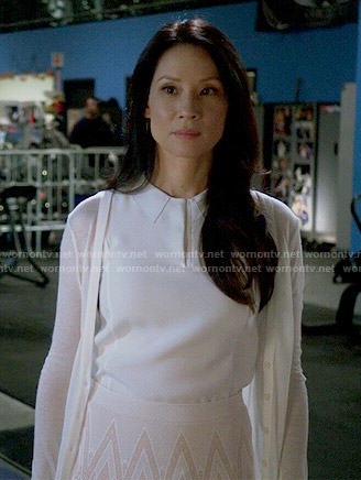 Joan's white collared top and chevron print skirt on Elementary