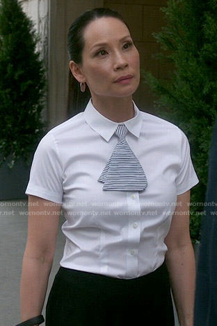 Joan's white shirt and striped mini-tie on Elementary