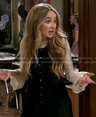 Maya's white lace top and black button front romper on Girl Meets World