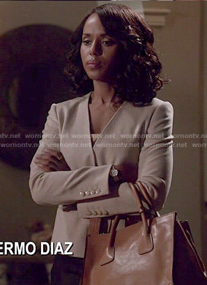 Olivia's wrap jacket and tan bag on Scandal