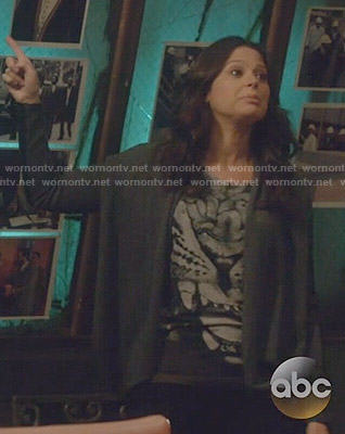 Quinn's tiger graphic tee and leather sleeved cardigan on Scandal