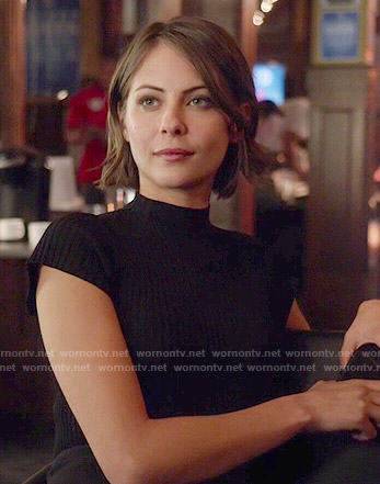 Thea's black mock-neck top on Arrow