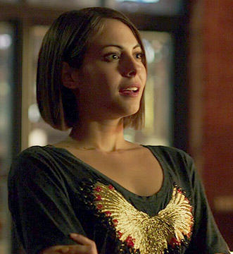Thea's gold embroidered eagle tee on Arrow