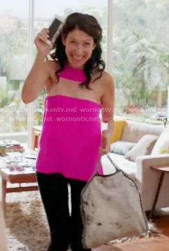 Abby's bright pink top with sheer panel on Girlfriends Guide to Divorce