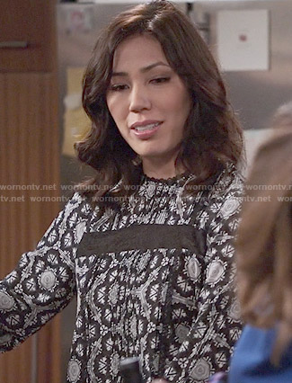 Angela's black and white printed blouse on Bones