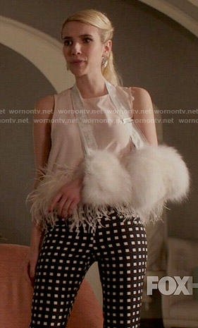 Chanel's checked trousers and feather trim top on Scream Queens
