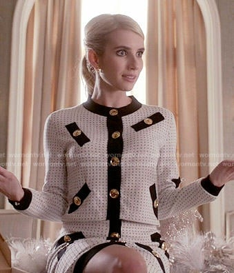 Chanel's white jacket and skirt set with black trim and gold buttons on Scream Queens