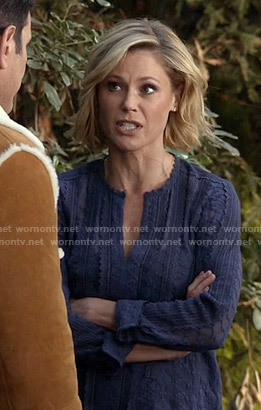 Claire's blue lace split-neck top on Modern Family