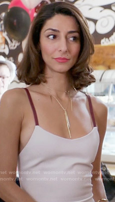 Delia's light pink dress with red straps on Girlfriends Guide to Divorce