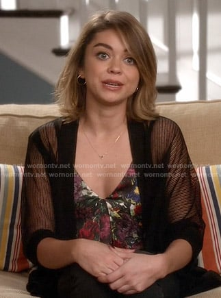 Haley's floral v-neck top and sheer black cardigan on Modern Family