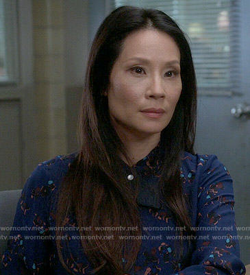 Joan's blue printed shirt on Elementary