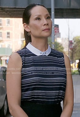 Joan's navy blue striped top with collar on Elementary