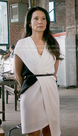 Joan's white and black pleated dress on Elementary