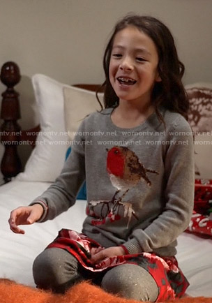 Lily's bird sweater and red floral skirt on Modern Family