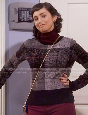 Mandy's black plaid sweater on Last Man Standing