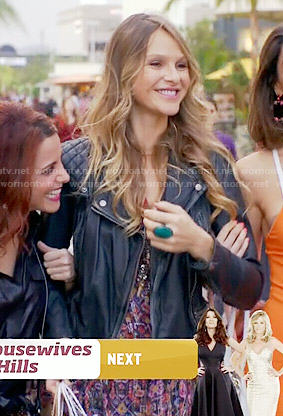 Phoebe's printed dress and leather jacket on Girlfriends Guide to Divorce