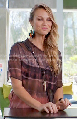 Phoebe's tie dye print top and feather earrings on Girlfriends Guide to Divorce