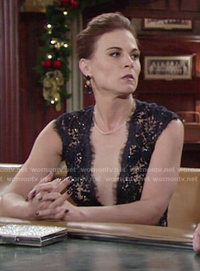 Phyllis's lace plunge neck gown at Abby's wedding on The Young and the Restless