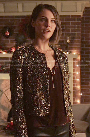 Thea's burgundy velvet top and embellished jacket on Arrow