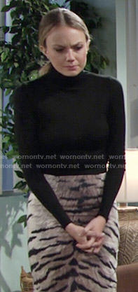 Abby's tiger stripe print skirt and black turtleneck on The Young and the Restless