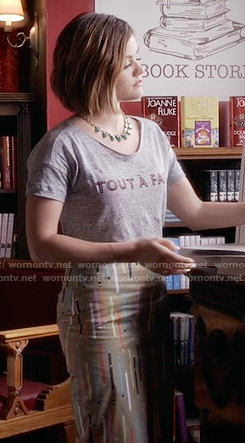 Aria's Tout A Fait tee and pencil print skirt on Pretty Little Liars