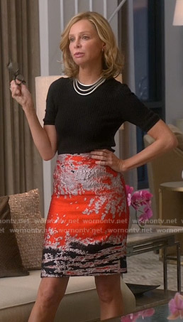 Cat's orange metallic print skirt and black sweater on Supergirl