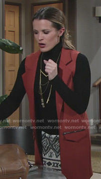 Chelsea's long orange vest on The Young and the Restless