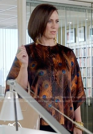 Diana's orange peacock feather print blouse on Younger