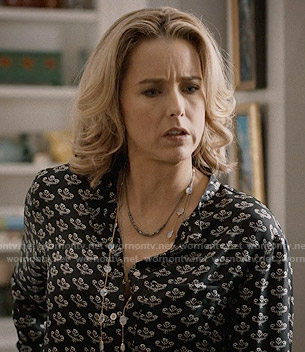 Elizabeth's black flower printed blouse on Madam Secretary