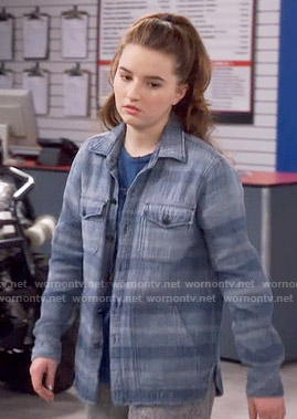 Eve's blue striped button down shirt on Last Man Standing