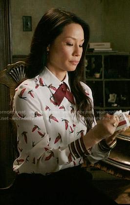Joan's bird print blouse on Elementary