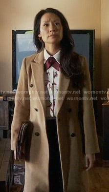 Joan's long camel coat on Elementary