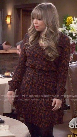 Kristin's black and orange printed long sleeve dress on Last Man Standing