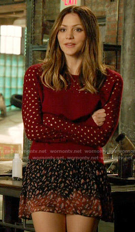 Paige's red perforated sweater and printed skirt on Scorpion